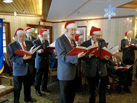 Members of the Minneapolis Knights of Columbus Male Chorus donned Santa hats for a Dec. 14 performance and sing-a-long for seniors at St. Therese Southwest Senior Care Community in Hopkins. Dianne Towalski / The Catholic Spirit