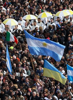 A man waves Argentina's flag as Pope Francis celebrates his inaugural Mass in St. Peter's Square at the Vatican March 19. CNS photo/Paul Haring