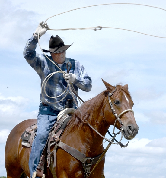 Bill Maassen of St. Croix Falls, Wis., with his horse, Poco Spanish Boy, gives a lasso demonstration during the Rural Life Sunday celebration.