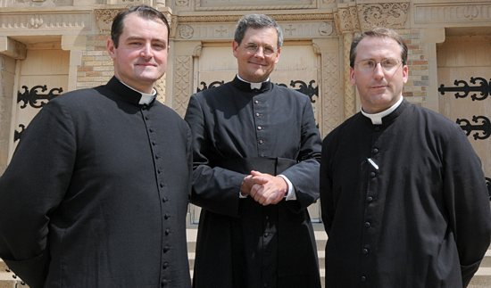 Father Simon Harkins, left, Father John Berg and Father Peter Bauknecht stand outside of All Saints in Minneapolis. The priests are members of the Priestly Fraternity of St. Peter. Fathers Bauknecht and Harkins began serving the parish in July; Father Berg, the fraternity's superior general, celebrated a solemn high Mass at the church Aug. 11. Dianne Towalski / The Catholic Spirit