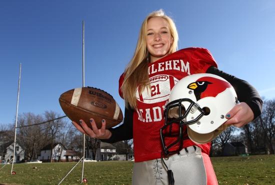 Lexi Temple, a junior at Bethlehem Academy in Faribault enjoys her role as kicker for the boys' varsity football team. Dave Hrbacek / The Catholic Spirit