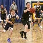 Priests prevail in hoops
