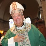 Local faithful flock to apostolic administrator's first Mass